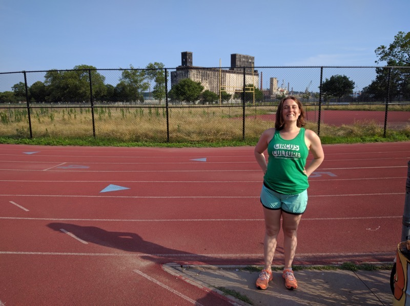 Photo of runner on track.