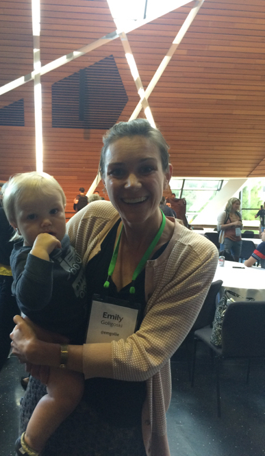 Woman holding child at SRCCON